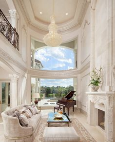 Elegant two-story Mediterranean style Formal Living Room with bowed, butted-glass windows, stacked for an impressive view & open feel...