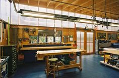 Look at this gorgeous workshop designed by Harrison Architects of Seattle. There are green features throughout the design, including a planted roof, and reclaimed cabinetry.