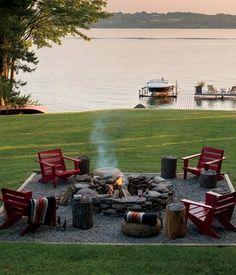 backyard fire pit. gravel around and framed with adirondak chairs - natureb4