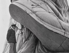 1937: Under the heel of the Statue of Liberty