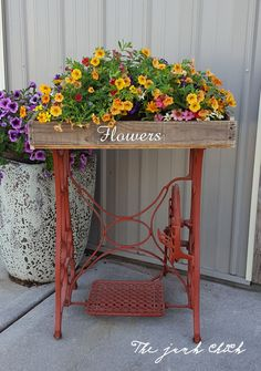 Repurposed old sewing machine into a flower stand. www.facebook.com/thejunkchick