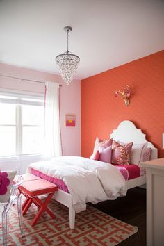 This is the perfect tween girl bedroom with colors of pink and coral, perfectly designed for playful sophistication.