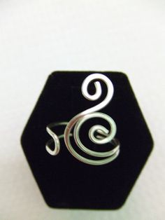 Natural Elements Spiral Ring Any Size Adjustable Swirl Ring Silver Ring Simple Ring Wire Wrap Ring Waves Ocean Wind Jewelry Gifts Under 10. $9.95, via Etsy.