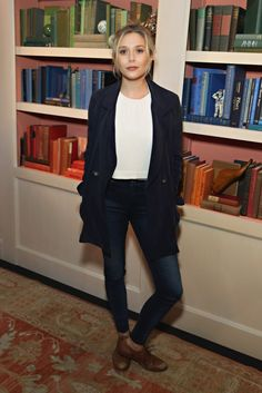 Elizabeth Olsen wears a white t-shirt, blazer, skinny jeans, and oxfords