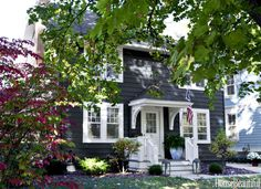 An almost black hue, Farrow & Ball's Railings modernizes the exterior of the 1920s Ann Arbor home.