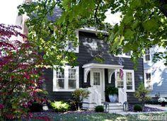 An almost black hue, Farrow & Ball's Railings modernizes the exterior of the 1920s Ann Arbor home.