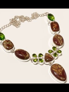 Jasper and green peridot set in .925 sterling silver necklace only on BANGLES AND BAUBLES ON FACEBOOK.  Where every purchase provides food and care for a homeless animal   Only $40.00