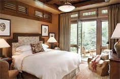 Indulgence of beautiful wood tones in this exclusive master bedroom a little on the masculine side, however still a charming room nevertheless