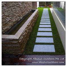 Zero maintenance walkway with stone steps and artificial turf