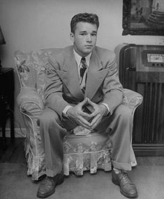 Teenage boy sitting in chair and wearing beige suit. Tulsa, OK, July 1947