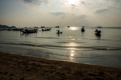 Man paddle a kayak in the ocean in the sunset by Koh Tao island in Thailand Stefan Johansson, Koh Tao, Paddle, Kayaking, Thailand, Ocean, Island, Sunset, Beach
