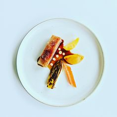 Duck  and five elements: endive in saffron water and orange juice, chard, carrot  purée, orange, demi glace duck  juice and shallot oil.