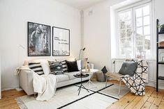 Modest living room of an elegant Stockholm apartment [Design: Britse & Company AB] Rooms Ideas, Style Deco, Scandinavian Living, Nordic Living, White Rooms, White Walls, Ceiling Decor, White Furniture, Living Room Inspiration