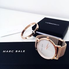 """Use the promo code """"ClassyInTheCityBlog"""" for 15% OFF your order.Stunning shot of our Metallic Stud Bangle and the @marcbaleofficial Rose Gold Mesh timepiece by @eugenia.tar! This watch comes with a free leather strap! @thepeachbox #thepeachbox #rosegoldlove #sweetsurprise"""