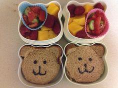 Bento with teddy bear sandwich, cucumber/tomato salad, mangoes, raspberries