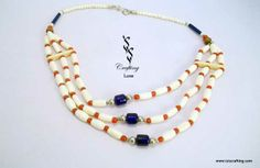 www.isiscrafting.com Made up of wooden hairpipes, this three-strand #necklace has been beautified using #pretty orange #beads joining the hairpipes. Underlining the impeccable design of the necklace are the blue solid glass beads placed in the middle of each strand. Easy to wear and #stylish to look at, this necklace can be worn by women spanning all groups. with #IsisCrafting.com