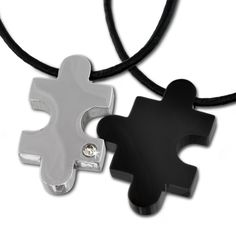 Amello stainless steel necklace set, puzzle black and puzzle stainless steel with white zirconia, 19.68 inch to 21.65 inch, original Amello ESK023S. stainless steel necklace set. con be worn together or separately. One puzzle piece is set with a white zirconia. The necklae is 19.68 inch long and can be extended with a 1.97 inch long extension chain to 21.65 inch. Each jewel comes in a free gift packaging.