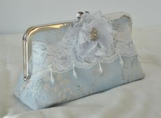 Light Blue Clutch / Fairy tale Clutch / by PetiteVintageBags This is the perfect size bag for wedding day essentials, mascara for touch-ups, tissues, chap stick, mints, and a cell phone!