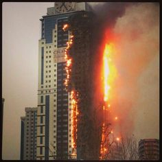 Chechnya High Rise Burns For 29 Hours With No Collapse, WTC 7? | World Truth.TV Hmm......