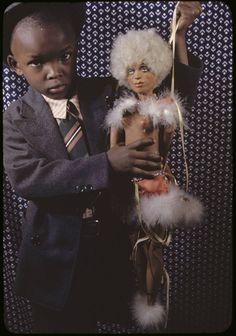 Carl Van Vechten - Jullius Perkins Jr, NYC, 1939. Although not mentioned at source, I believe that is a Josephine Baker marionette.