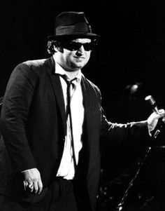 "John Belushi was 33 years old when his lifeless body was discovered in a bungalow at famed Los Angeles hotel the Chateau Marmont. Belushi was a comedian and actor best known as one of the original cast members on ""Saturday Night Live."" His cause of death was a drug overdose from a lethal combination of cocaine and heroin. Belushi is pictured performing with the Blues Brothers in 1980."
