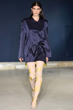 The complete Thomas Tait Spring 2015 Ready-to-Wear fashion show now on Vogue Runway.