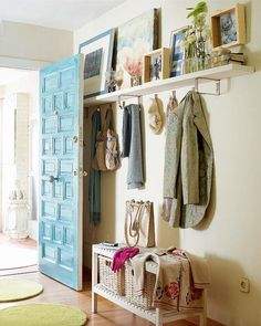 Entryway. An open storage wood bench, several metal hanging hooks and a contemporary wall shelf provides a practical and chic solution for organization in a casual entryway.