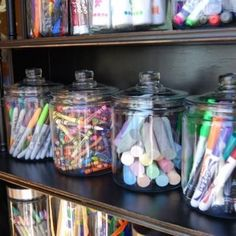 Easy Access Art Supplies...supplies containers look great on display. next to chalkboard wall in kitchen!