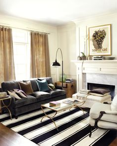 We love this bold striped rug paired with a deep, rich, dark gray velvet sofa.