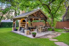 This freestanding covered patio with an outdoor kitchen and fireplace is the perfect retreat from the constraints of the house.  The homeowner had an existing structure located in their back yard that we demolished and built them this beautiful new space.