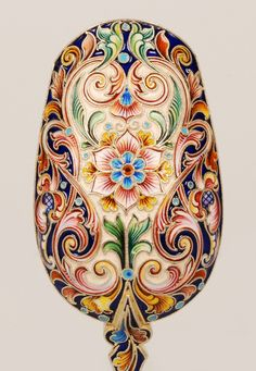 A Russian gilded silver and shaded cloisonné enamel caddy spoon by Feodor Ruckert, Moscow, circa 1896-1908. Beautifully decorated with scrolling florals against a cream and blue ground, with a monogrammed bowl.