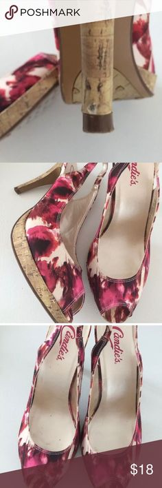 "Candies Size 8 Floral Heels Candies women's size 8 US abstract floral heels. In good used condition. There's a small knick out of the cork on the back of one of the heels (see pic)- some spots on footbed, some wear on bottoms, and very minor cosmetic wear typical of pre owned footwear.  Heels 3"" approximate insole length measurement 10"". Candie's Shoes Heels"