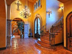 Gorgeous Spanish hacienda-styled home featuring a tiled entry, foyer, staircase and risers! When can we move in?