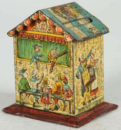 Tin Litho Punch & Judy Still Bank.  Circa 1910. Manufactured in Germany. Working key lock in roof with key. Tin money guard.