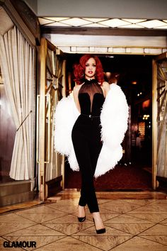 Rihanna. Her red hair is AMAZING in this picture. Actually this picture and entire outfit screams sex and power. LOVE IT!