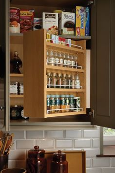Swing-out spice rack by Wood-Mode...organization on top of organization http://www.CabinetsAndDesigns.net/Products/Wood-Mode/