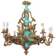Chandelier in Gilded Bronze and Porcelain | From a unique collection of antique and modern chandeliers and pendants at https://www.1stdibs.com/furniture/lighting/chandeliers-pendant-lights/