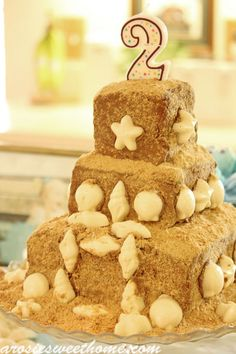How to make a Sandcastle Cake- this was actually a birthday cake, but it's a cute and inexpensive DIY beach wedding cake idea
