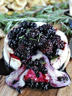 An easy, stunning and gluten free appetizer, this Rosemary Berry Baked Brie is a creamy and flavorful showstopper topped with coconut roasted berries.