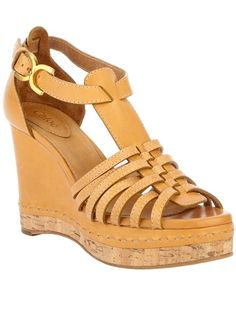 Tan leather sandal from Chloé featuring an open toe, a cork platform and wedge heel, a leather sole and a back strap with a gold-tone buckle fastening. £489.00