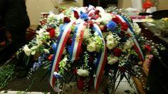 Red, white and blue casket spray doristhefloristt.com