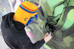 David Choe and Dhear painting a mural on the streets of Mexico City.  www.davidchoe.com