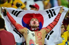 A South Korean fan reacts during football match in the Pantanal Arena, Cuiaba #Brazil during the 2014 FIFA World Cup #WorldCup #SouthKorea #Football