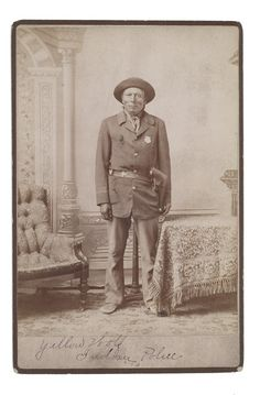 Yellow Wolf photographed in his Reservation Police outfit.