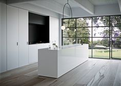 Kitchen dreams are made of this.who are we to disagree. Pared back simplicity thanks to benchtops, wide oak floors and floor to ceiling steel windows House, Countertops, Home, Home Values, Copenhagen Design, Oak Floors, Caesarstone, Renovations, Wide Oak Flooring