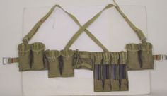 Rifleman Rig-Original Chinese military chest pouch. Adjustable heavy canvas web shoulder straps have leather keepers. Constructed of heavy O.D. cotton ca... doomsdaysurvivalstore.net