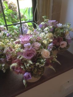 Buckets of flowers at Coombe Lodge