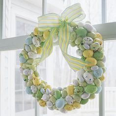 Wreaths aren't just for winter! To make this festive springtime wreath, cut skewers into two-inch lengths, leaving one end sharp. Using a paring knife, pierce shells of speckled malted-milk eggs and insert skewer tips. Push candy into an eight-inch foam ring; top with ribbon
