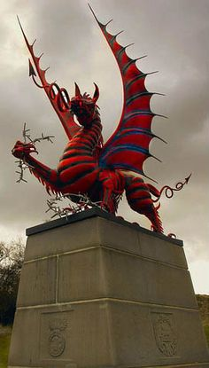 This is how the 38th (Welsh) Division Memorial erected, with a defiant dragon (the Red Dragon of Wales was the division's insignia) standing on a 10 feet plinth, facing the woods with the regimental cap badge of the South Wales Borderers carved on one side of the base.