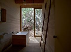 Simple fittings and timber panelling give Japanese aesthetic to this bathroom from Pirates Bay House by O'Connor and Houle Architecture. Sustainable Architecture, Interior Architecture, Timber Panelling, Yellow Doors, Wooden Bathroom, Slow Living, Mid Century Design, Interior Design Inspiration, Bathroom Interior